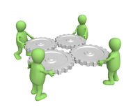 Teamwork. Four puppets, holding in hands a gears Royalty Free Stock Images