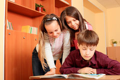 Teamwork. Educational theme: schoolchildren in a classroom Stock Photos
