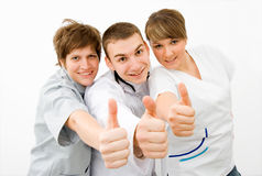Teamwork. Team of young doctors a over white background Stock Photo