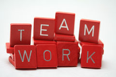 Teamwork. Written in little red blocks Royalty Free Stock Images