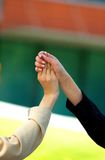 Teamwork. Two business women grasp hands as congratulations for good team work Royalty Free Stock Photo