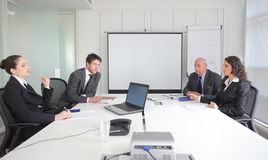 Teamwork. Business people sitting at a table and having a meeting Stock Images