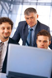 Teamwork. Closeup of a group of business people working on laptop with their manager at the office Royalty Free Stock Image