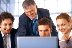 Teamwork. Closeup of a group of business people working on laptop with their manager at the office Stock Photos