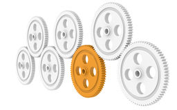 Teamwork. 7X Gears, one Orange. Isolated Stock Photography
