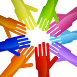 Teamwork. Colorful hands rally together in unison Royalty Free Stock Image