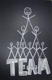 Teamwork. People team drawn in chalk on blackboard stock image