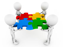Teamwork. Resolving concept, team members putting a puzzle together, in different colors Stock Image