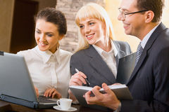 Teamwork. Portrait of three young confident specialists at a meeting royalty free stock photography