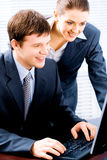 Teamwork. Portrait of two confident business people working together Stock Images