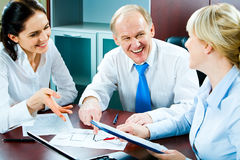 Teamwork. Portrait of smiling people planning business-strategy Stock Photos