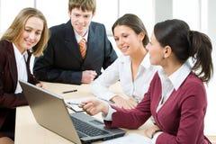 Teamwork. A businesswoman holds a mini presentation royalty free stock photos