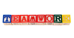 Teamwork. The word teamwork, spelled using colored letter blocks, isolated against a white background Royalty Free Stock Photo