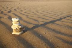 Teamwork. Stone on the beach, sunshine shadow Royalty Free Stock Photo