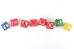 Teamwork - Alphabet Baby Blocks on white Royalty Free Stock Photos