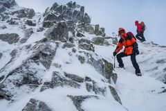 Teamwork in alpinism. Mountaineering. Traverse of mountain. royalty free stock images