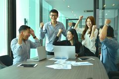 Teamwork of Asian business people succeed a project, tag team stock image