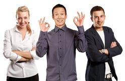 Teamwork and Asian Man Shows OK Stock Photos