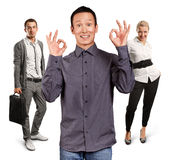 Teamwork and Asian Man Shows OK Royalty Free Stock Images