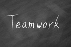 Teamwork on Blackboard Stock Photography