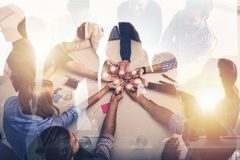 Teamwork and brainstorming concept with businessmen that share an idea with a lamp. Concept of startup. Double exposure. Teamwork and brainstorming concept with royalty free stock photos