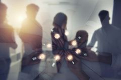 Teamwork and brainstorming concept with businessmen that share an idea with a lamp. Concept of startup. Double exposure royalty free stock photos