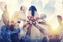 Teamwork and brainstorming concept with businessmen that share an idea with a lamp. Concept of startup. Double exposure. Teamwork and brainstorming concept with royalty free stock photo