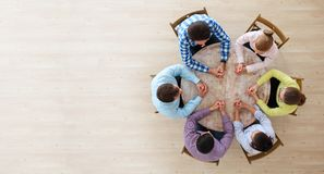 Teamwork brainstorming meeting. Startup diversity teamwork brainstorming meeting concept, people sitting around the table royalty free stock photography