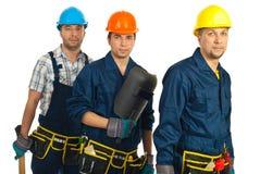 Teamwork of builders men stock image