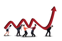 Teamwork with business chart and upward arrow Royalty Free Stock Photo