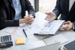 Teamwork of business colleagues, consultation new strategy plan business and market growth on financial document graph report,. Conference to making growth royalty free stock image