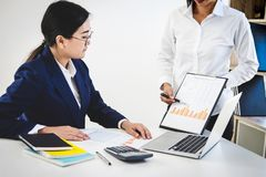 Teamwork of business colleagues consultation and presentation ne. W strategy plan business and market growth on financial document graph report, professional Stock Photo