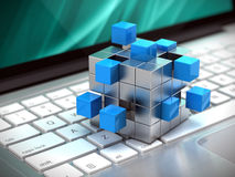 Teamwork business concept - cube assembling from blocks on laptop keyboard. 3d rendering Royalty Free Stock Photography
