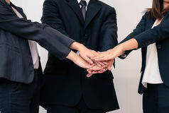 Teamwork, business concept joining hands stock photo