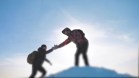 Teamwork business concept victory help hands arm slow motion video. team group tourist hikers gives a helping hand. Success win winter reached the top of the stock video
