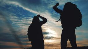 Teamwork business journey concept win. couple man and woman jump joy hold hand silhouette. slow motion video. teamwork. Couple husband and wife hikers sunshine stock footage