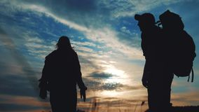 Teamwork business journey concept win. couple man and woman jump joy hold hand silhouette. slow motion video. teamwork. Couple husband lifestyle and wife hikers stock video footage