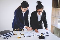 Teamwork of business lawyer colleagues, consultation and conference of professional female lawyers working having at law firm in. Office. Concepts of law, Judge royalty free stock photo
