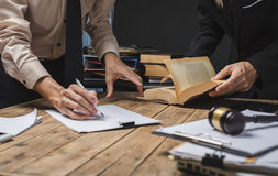 Teamwork of business lawyer meeting working hard about legal reg. Islation in courtroom to help their customer Royalty Free Stock Image