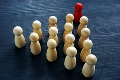 Teamwork in business and leadership. Wooden figures on the desk royalty free stock photo
