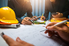 Teamwork of business man contractor working meeting in the office construction site on their architect project. royalty free stock photos