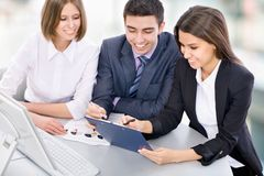 Teamwork. Business men showing something on computer screen to colleagues Royalty Free Stock Images