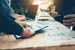 Teamwork with business people analysis cost graph on desk at meeting room.  stock images