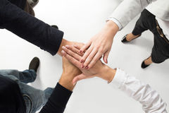Teamwork. business people joined hands Stock Photos