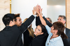 Teamwork - business people with joint hands in the royalty free stock images