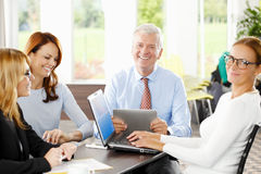 Teamwork. Business people with laptop working together on financial plans. Teamwork Stock Photo