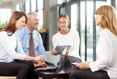 Teamwork. Business people with laptop working together on financial plans. Teamwork Royalty Free Stock Photo
