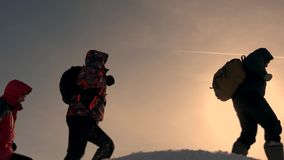 Teamwork of business people. three climbers climb one after another on a snow-covered hill. team of business people go. Teamwork of business people. three stock video