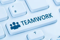 Teamwork business team online internet blue computer keyboard Royalty Free Stock Image