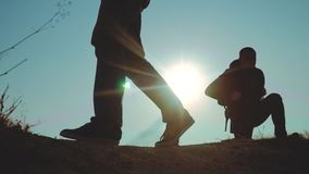Teamwork business travel concept. Legs silhouette group hikers of people walking on the top of the mountain with. Teamwork business travel concept. Legs stock footage